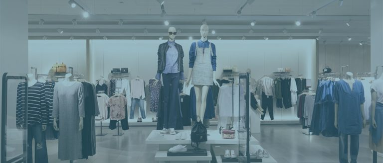 Mannequins and clothing racks in a retail store