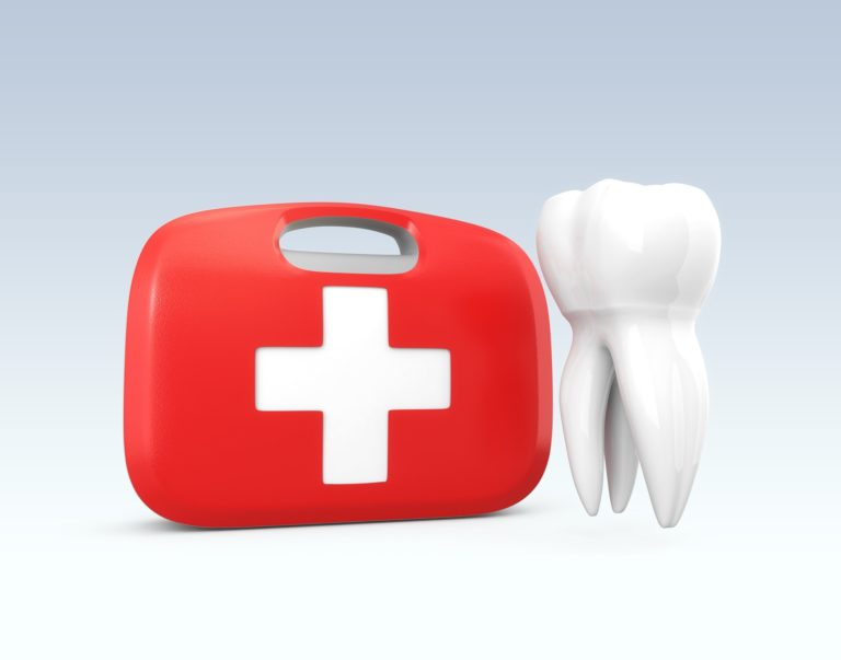 red first-aid kit with a white cross next to a white tooth representing emergency dentistry services at normandy dentistry and lakewood dentistry in jacksonville florida