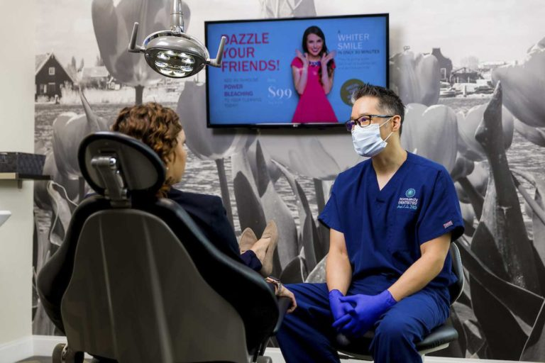 A dentist consulting with a dental patient